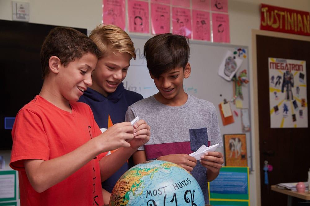 Middle School social studies students celebrate Y1K win