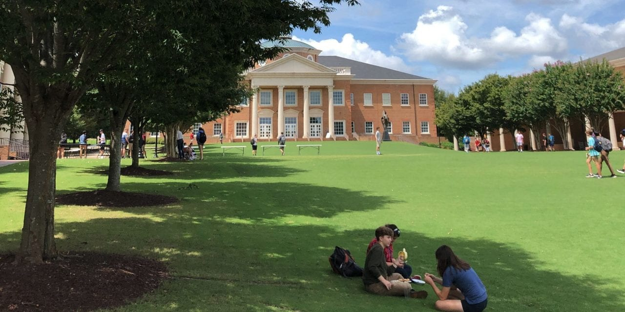 CA Students sitting on the Quad