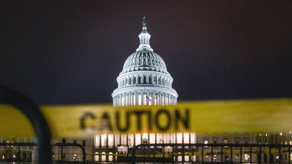 The U.S. Capitol behind caution tape